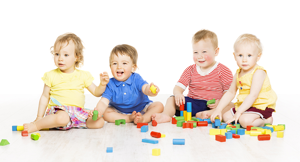 Children group playing toy blocks. Baby Kids development, isolated over white background